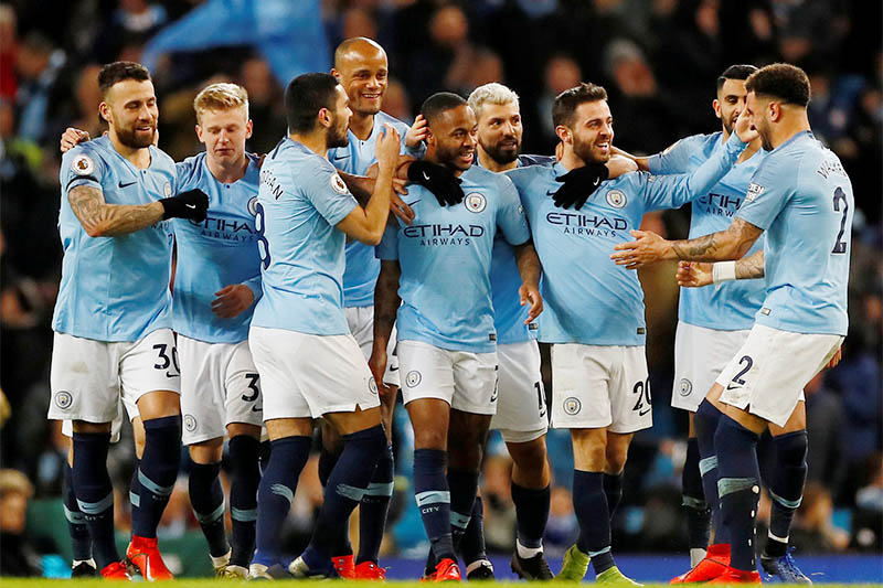 Manchester City's Raheem Sterling celebrates scoring their first goal with team mates. Photo: Reuters