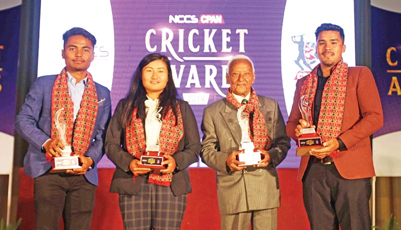 Rohit Paudel, Sita Rana Magar, Komal Bahadur Pandey and Karan KC pose after winning the NCCS CPAN Cricket Awards.  Photo: Udipt Singh Chhetry/THT