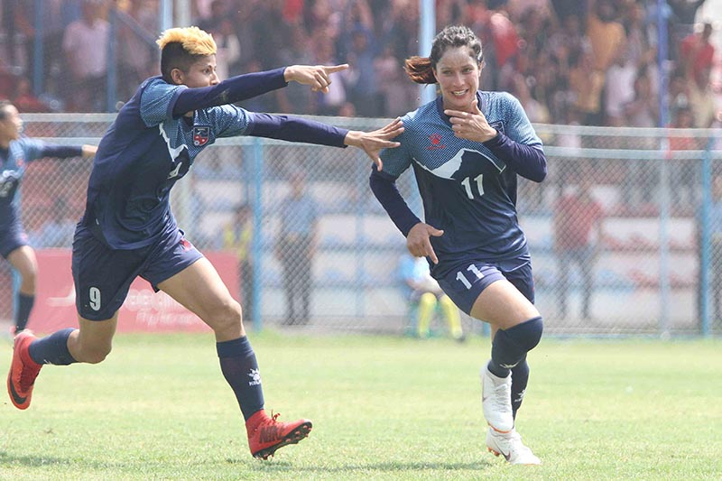 Anita Basnet (right) celebrates goal with team mate Sabitra Bhandari against Sri Lanka during their SAFF Championship semi-final match at Shahid Rangasala in Biratgnagar on Wednesday, March 20, 2019. Photo: Udipt Singh Chhetry