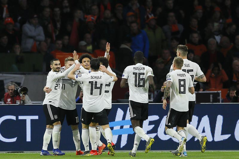 Germany's Nico Schulz (fourth from left) celebrates with his teammates after scoring his side's third goal during the Euro 2020 group C qualifying soccer match between Netherlands and Germany at the Johan Cruyff ArenA in Amsterdam, Sunday, March 24, 2019. Photo: AP