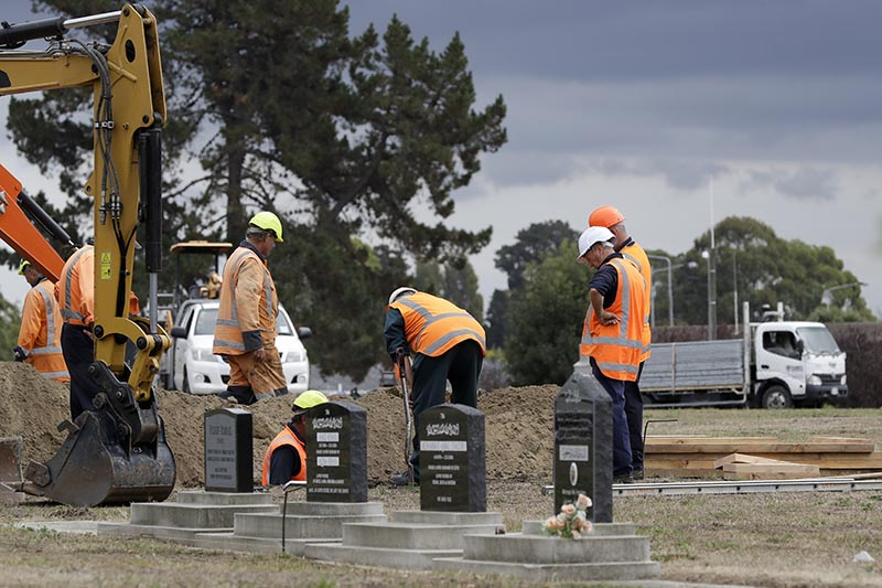 Workers dig graves at a Muslim cemetery in Christchurch, New Zealand, on Saturday, March 16, 2019, for victims of a mass shooing at two area mosques. Photo: AP