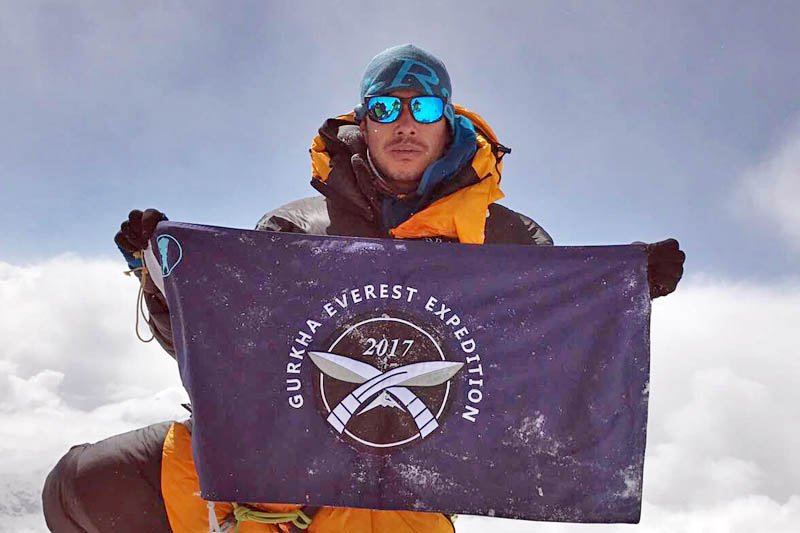 FILE - A former Gurkha soldier and a mountaineer, Nirmal Purja, holds a banner of Gurkha Everest Expedition. Photo: THT