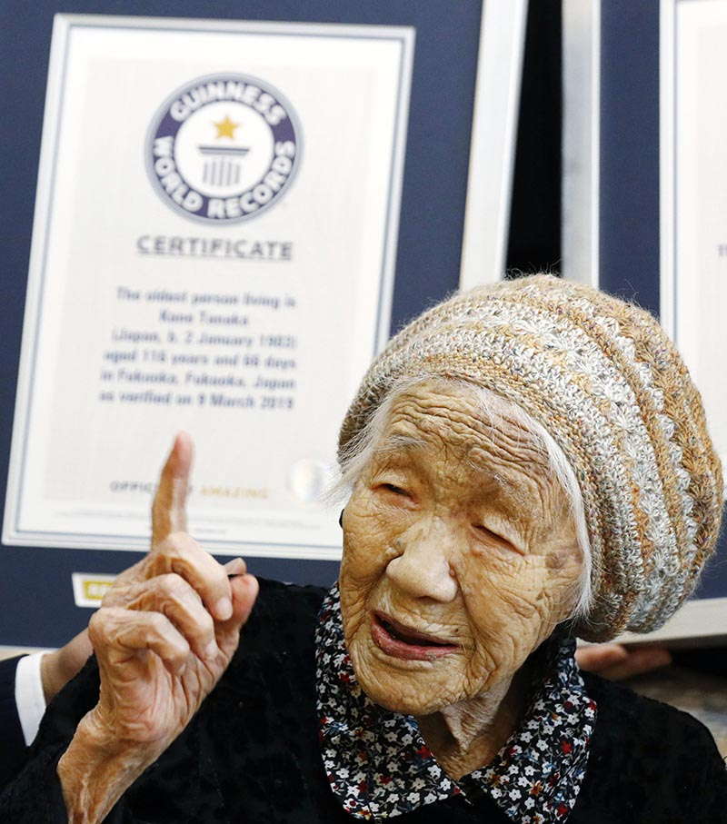 Kane Tanaka, a 116-year-old Japanese woman, gestures after receiving a Guinness World Records certificate, back, at a nursing home where she lives in Fukuoka, southwestern Japan, on Saturday, March 9, 2019. Tanaka who loves playing the board game Othello was honored Saturday as the world's oldest living person by Guinness World Records. Photo: Takuto Kaneko/Kyodo News via AP