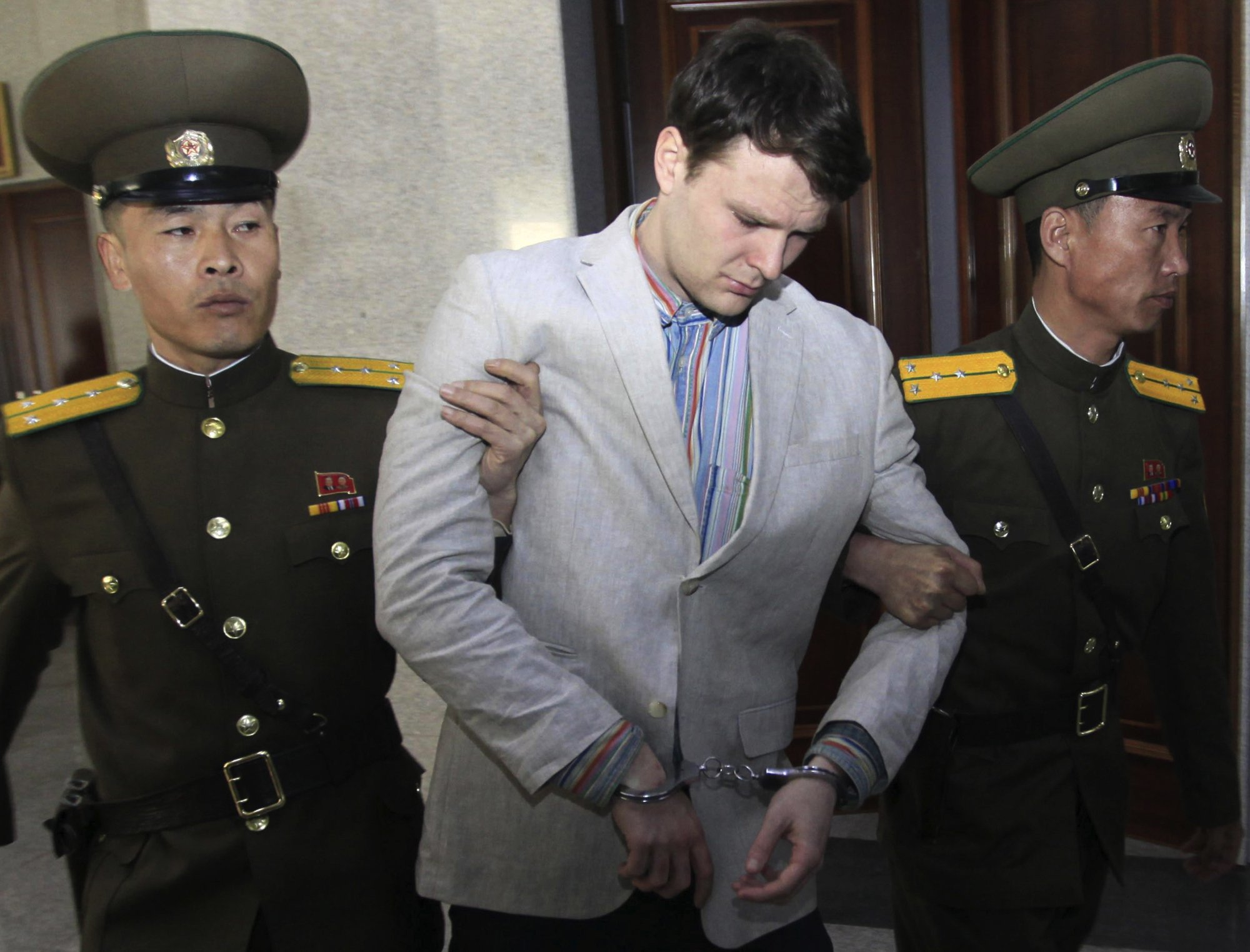 FILE - In this March 16, 2016, file photo, American student Otto Warmbier, center, is escorted at the Supreme Court in Pyongyang, North Korea. Photo: AP