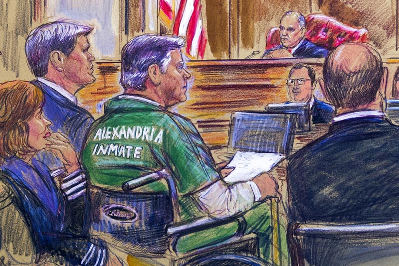 This courtroom sketch depicts former Trump campaign chairman Paul Manafort, center in a wheelchair, during his sentencing hearing in federal court before judge TS Ellis III in Alexandria, Virginia, Thursday, March 7, 2019. Photo: Dana Verkouteren via AP