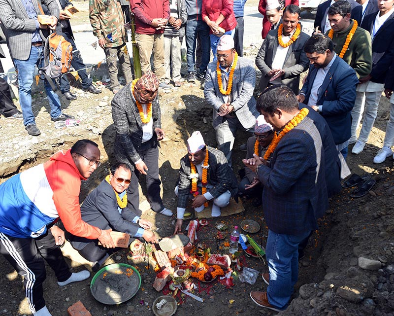 Minister for Youth and Sports Jagat Bahadur Sunar (right) and National Sports Council Member Secretary Keshab Kumar Bista laying the foundation stone of Pokhara Stadium in Kaski on Sunday, March 10, 2019. Photo: THT