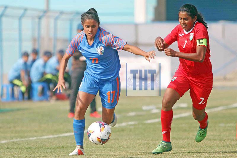Dalima Chhibber (left) of India vies for the ball against Fadhuwa Zahir skipper of Maldives during the Womenu2019s SAFF Championship at Shahid Rangasala in Biratnagar on Wednesday. Photo: Udipt Singh Chhetry/THT