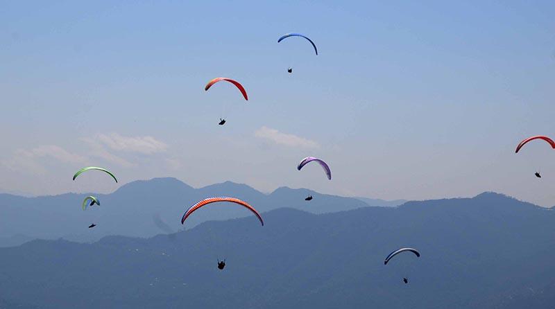 FILE - Domestic tourists enjoying paragliding in Sarangkot, Pokhara, on Tuesday, March 5, 2019. Photo: THT