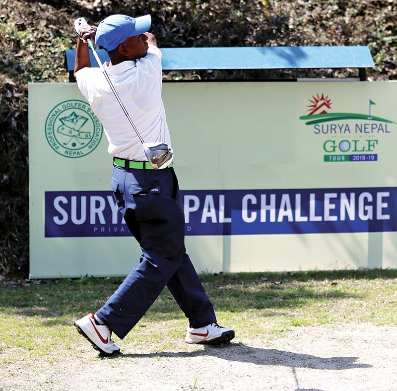 Rame Magar plays a shot on the first hole during the third round of the Surya Nepal Challenge at the Royal Nepal Golf Club in Kathmandu on Thursday. Photo: THT