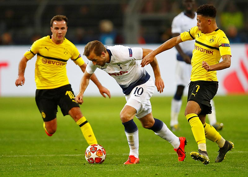 Borussia Dortmund's Jadon Sancho and Mario Goetze in action with Tottenham's Harry Kane during the Champions League Round of 16 Second Leg match between Borussia Dortmund and Tottenham Hotspur, at Signal Iduna Park, in Dortmund, Germany, on March 5, 2019. Photo: Reuters