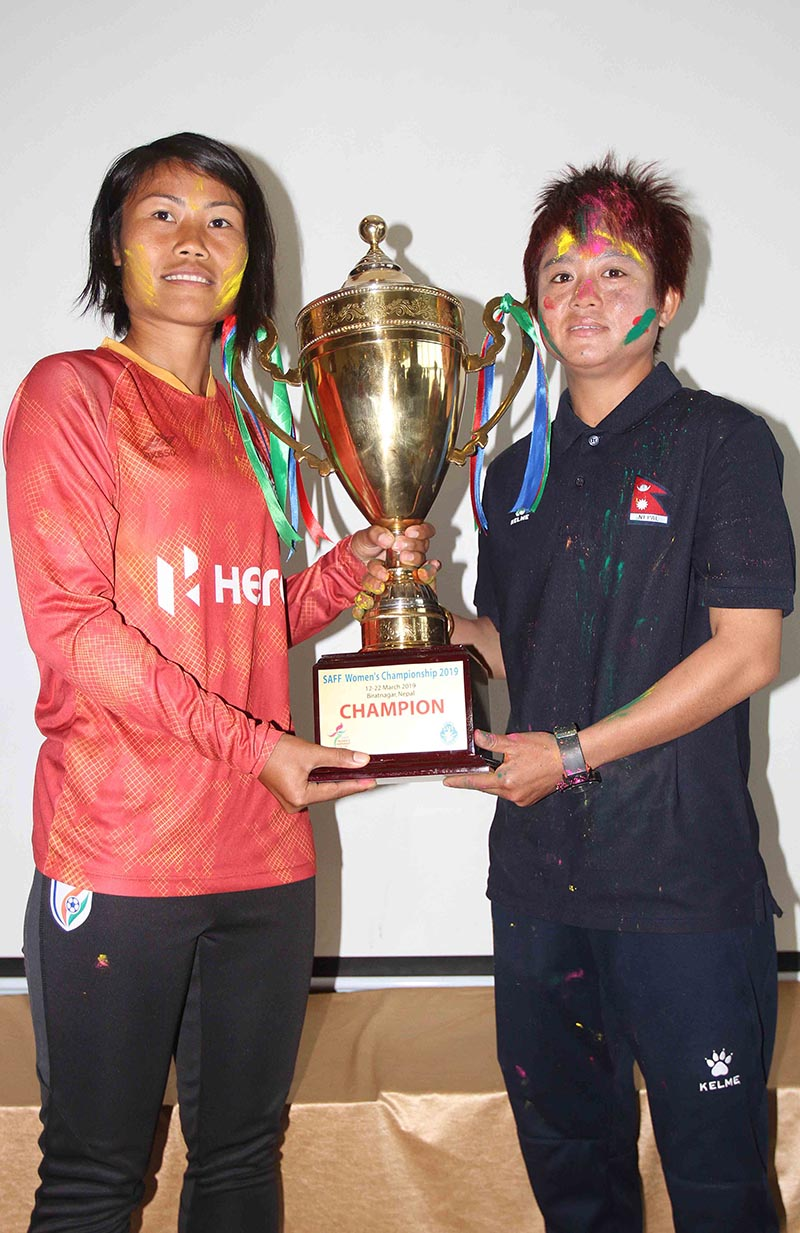 Ashalata Devi Loitongbam (left) and Niru Thapa respectively skippers of India and Nepal take photo with winner's trophy on the eve of final match during press meet of the SAFF Women's Championship at Sahhid Rangasala in Biratnagar on Thursday, March 21, 2019. Photo: Udipt Singh Chhetry/ THT