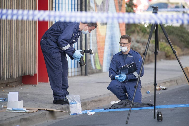 Forensic police examine items at the scene of a multiple shooting outside Love Machine nightclub in Melbourne, Sunday, April 14, 2019. Photo: Ellen Smith/AAP Image via AP