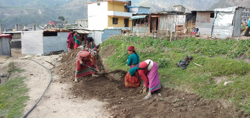 Women laying out the drinking water line, in Badimalika Municipality, Bajura, on Saturday, April 20, 2019. Photo: Prakash Singh/THT