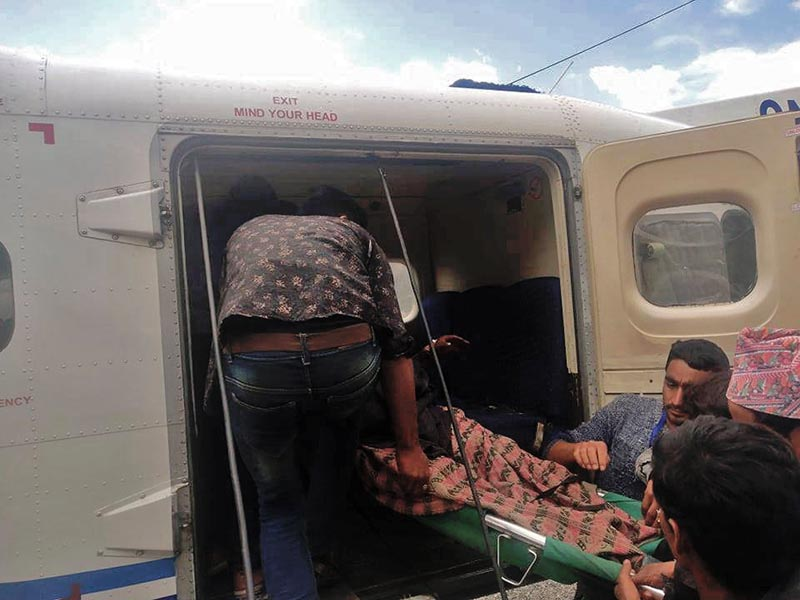 A patient being airlifted to Nepalgunj in Budhinanda Municipality-3 of Bajura, on Monday, April 1, 2019. Photo: Prakash Singh/ THT