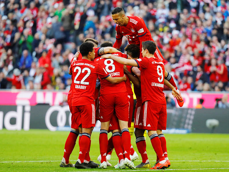 Bayern Munich's Mats Hummels celebrates scoring their first goal with team mates. Photo: Reuters