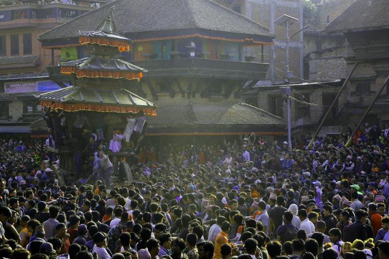 Devotees pull ropes tied to a chariot of Lord Bhairav during Biska: Jatra Festival in Taumadi, Bhaktapur, on Wednesday, April 10, 2019. During the festivities, images of Bhairav and his female counterpart Bhadrakali are enshrined in two large chariots and pulled to an open square after which rituals and festivities are performed. Photo: APnnnn