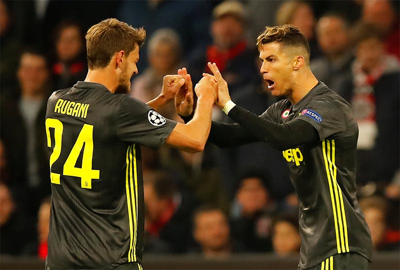 Juventus' Cristiano Ronaldo celebrates scoring their first goal with Daniele Rugani during the Champions League Quarter Final First Leg match between Ajax Amsterdam and Juventus, at Johan Cruijff Arena, in Amsterdam, Netherlands, on April 10, 2019. Photo: Reuters