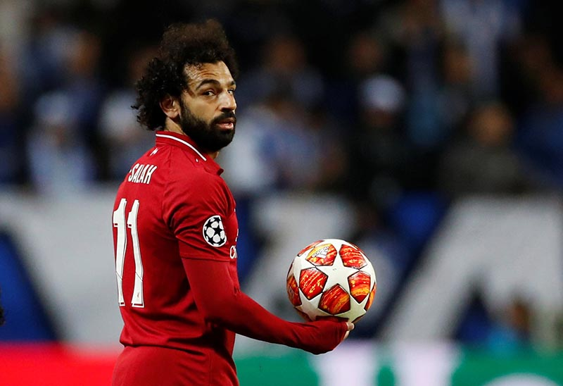 Liverpool's Mohamed Salah with the match ball during the Champions League Quarter Final Second Leg match between FC Porto and Liverpool, at Estadio do Dragao, in Porto, Portugal, on April 17, 2019. Photo: Action Images via Reuters