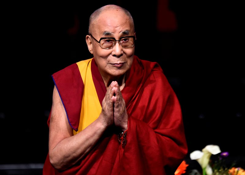 FILE: Tibetan spiritual leader the Dalai Lama, Patron of Children in Crossfire, gestures at an event called 'Compassion in Action' in Londonderry, Northern Ireland September 10, 2017. Photo: Reuters/file
