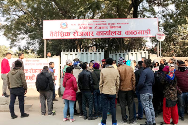 A crowd of foreign aspirant workers wait outside the Department of Foreign Employment office in Kathmandu.