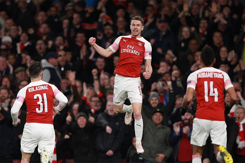 Arsenal's Aaron Ramsey celebrates scoring their first goal with Sead Kolasinac and Pierre-Emerick Aubameyang       during the Europa League Quarter Final First Leg, on Arsenal and Napoli, at Emirates Stadium, in London, Britain , on April 11, 2019. Photo: Reuters