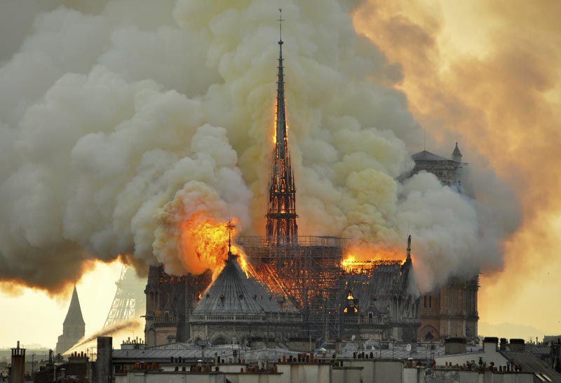 FILE - Flames and smoke rise from the blaze at Notre Dame cathedral in Paris, Monday, April 15, 2019. Photo: AP