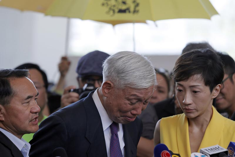 Occupy Central leader Chu Yiu-ming, center, cries as he speaks to media after sentencing at a court in Hong Kong, Wednesday, April 24, 2019.  Photo: AP