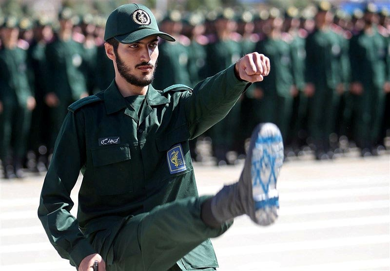 FILE - An Iranian Officer of Revolutionary Guards, with Israel flag drawn on his boots, is seen during graduation ceremony, held for the military cadets in a military academy, in Tehran, Iran, on June 30, 2018. Tasnim News Agency via Reuters