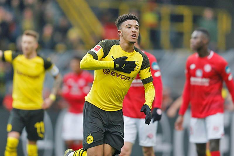 Borussia Dortmund's Jadon Sancho celebrates scoring their second goal. Photo: Reuters