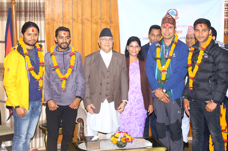 Prime Minister KP Sharma Oli bidding adieu to a team set to re-measure the height of Mt Everest at a programme organised in Kathmandu, on Wednesday, April 10, 2019. Photo: RSS