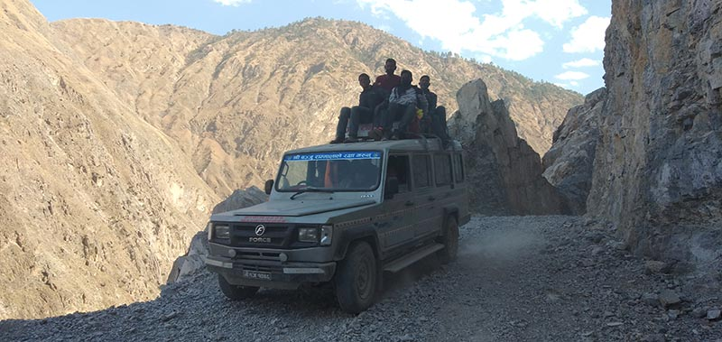 An overloaded jeep plying Karnali Corridor of Bajura road stretch carry passengers on the roof, in Bajura district, on Monday, April 8, 2019. Photo: Prakash Singh/THT