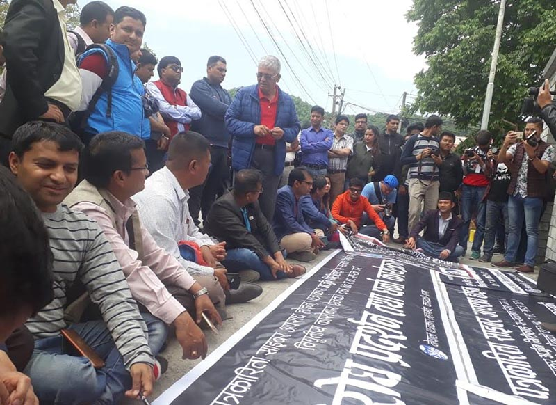Journalists staging a sit-in demanding the release of arrested journalist Arjun Giri in front of District Administration Office, Kaski, on Thursday, April 18, 2019. Photo: THT