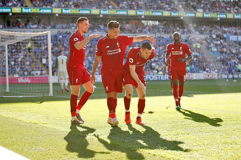 FILE: Liverpool's James Milner celebrates scoring their second goal with team mates. Photo: Reuters