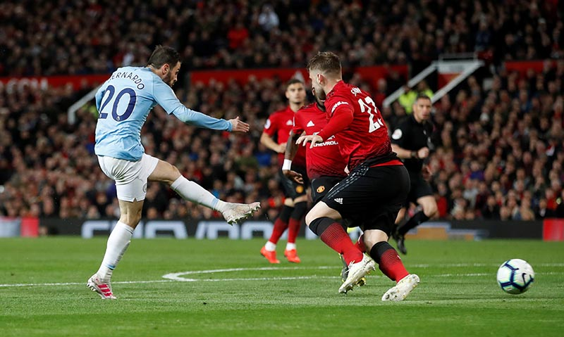 Manchester City's Bernardo Silva scores their first goal during the Premier League match between Manchester United and Manchester City, at Old Trafford, in Manchester, Britain, on April 24, 2019. Photo: Action Images via Reuters