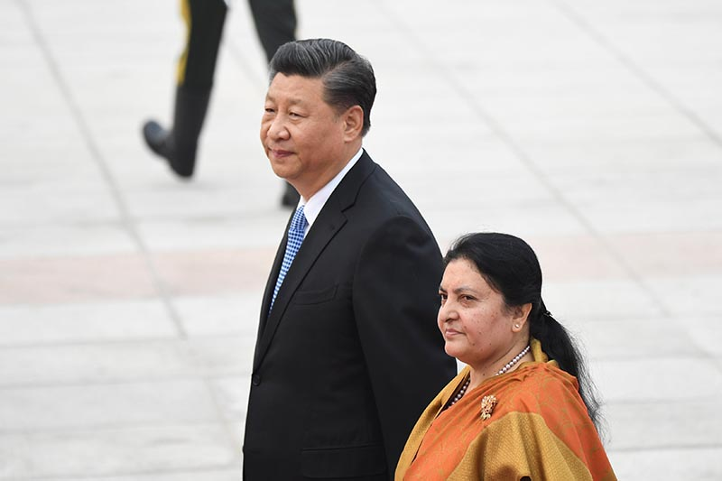 Nepal's President Bidya Devi Bhandari and China's President Xi Jinping walk together during a welcome ceremony at the Great Hall of the People in Beijing, China, on Monday, April 29, 2019. Photo: Madoka Ikegami/Pool via REUTERS