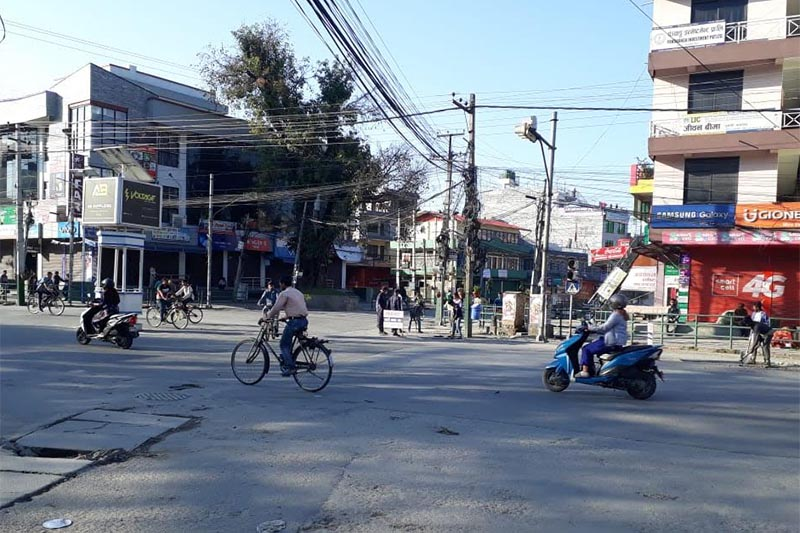A few vehicles plying the road due to the bandh called by Netra Bikram Chand-led Communist Party of Nepal at Srijana Chowk; a bomb disposal team of the Nepali Army defusing a bomb planted at New Road, Pokhara, on Thursday, April 18,  2019. Photo: THT