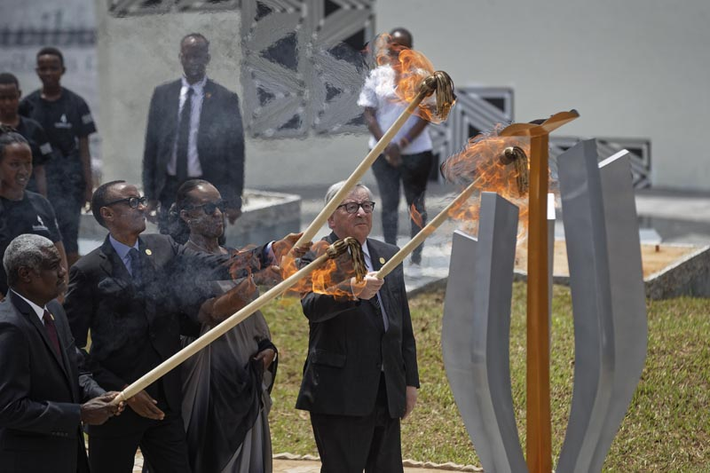 From left to right, Chairperson of the African Union Commission Moussa Faki Mahamat, Rwanda's President Paul Kagame, Rwanda's First Lady Jeannette Kagame, and President of the European Commission Jean-Claude Juncker, light the flame of remembrance at the Kigali Genocide Memorial in Kigali, Rwanda, Sunday, April 7, 2019. Photo: AP