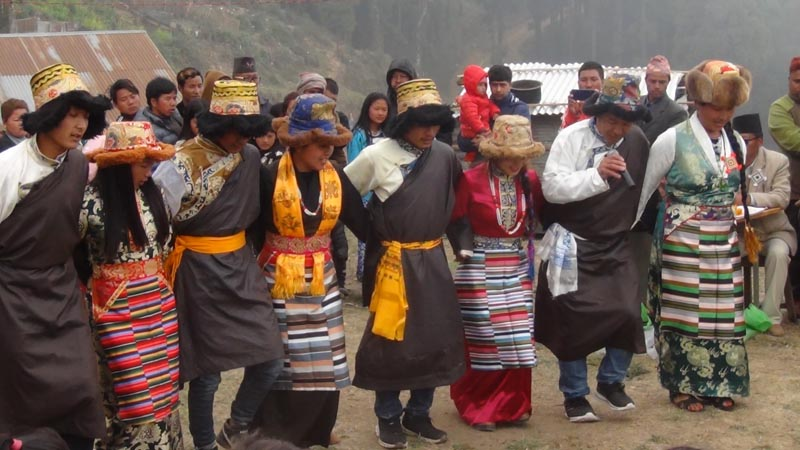 Men and women from the Sherpa community performing cultural dance at Ranke Bazaar, in Panchthar district, on Wednesday, April 24, 2019. Photo: Laxmi Gautam/THT