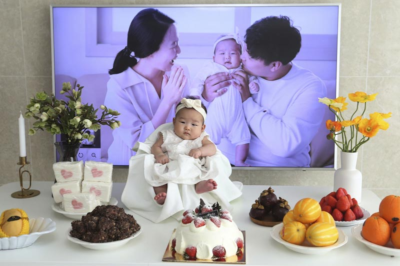 In this April 9, 2019, photo, Lee Dong Kil's daughter Lee Yoon Seol sits to celebrate her the 100th day of the birth at Lee's house in Daejeon, South Korea. Photo: AP