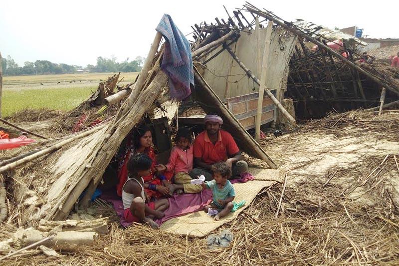 A Dalit family taking shelter under a damaged hut in Hardiya village of Subarna Rural Municipality, in Bara, on Wednesday, April 3, 2019. Photo: Prabhat Kumar Jha/THT