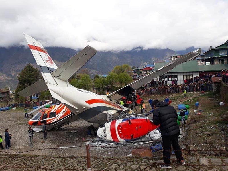The remnants of a Summit Air Let L-410 Turbolet aircraft after it hit two helicopters during take off at Lukla airport, on Sunday, April 14, 2019. Three persons were killed in the incident. Photo Courtesy: Devraj Lama