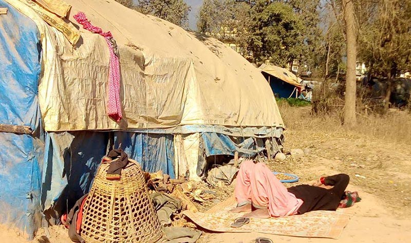 A flood victim sleeping outside  a make-shift tent, in Birendranagar, Surkhet, on Wednesday, April 11, 2019. Photo: THT