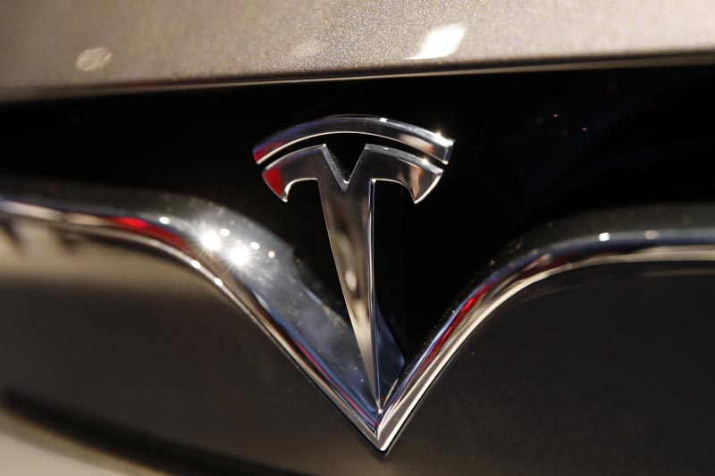 FILE: This October 3, 2018, file photo shows a Tesla emblem at the Auto show in Paris. Photo: AP/file