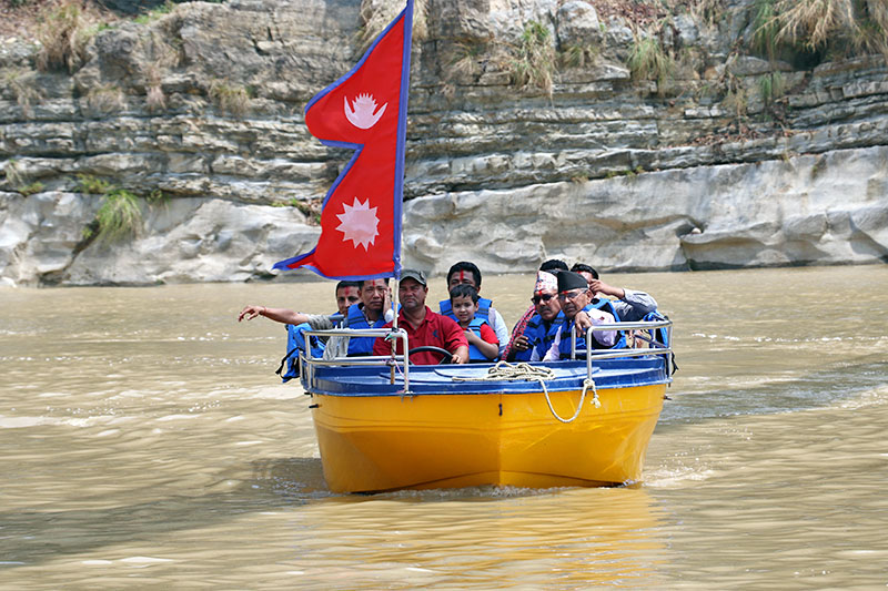 Officials conducting a motor-boat test ride to operate waterway along Bagmati River in Makwanpur district, on Sunday, April 14, 2019. Photo: Prakash Dahal/THT
