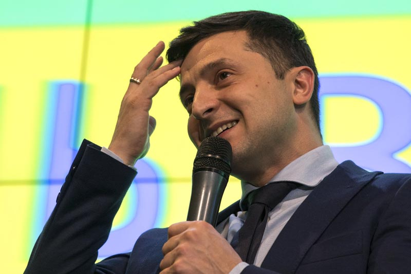 Ukrainian comedian Volodymyr Zelenskiy, reacts as he responds to a journalist question during a press conference, after the presidential elections in Kiev, Ukraine, Sunday, March. 31, 2019.