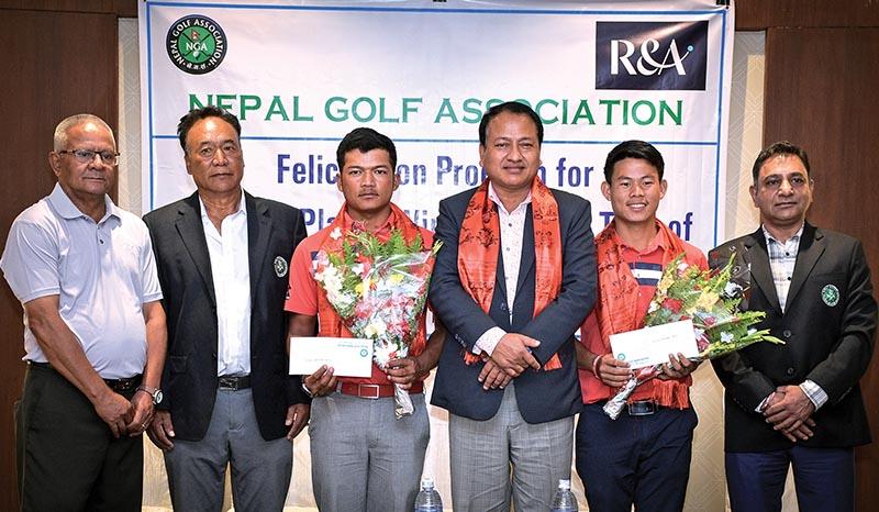 Amateur golfers Tanka Bahadur Karki (third from left) and Sukra Bahadur Rai (second from right) pose for a photo with officials at a felicitation programme in Kathmandu on Saturday. Photo: Naresh Shrestha / THT