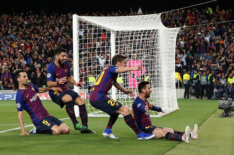 Barcelona's Lionel Messi celebrates scoring their third goal with Sergi Roberto, Luis Suarez and Sergio Busquets during the Champions League Semi Final First Leg match between FC Barcelona and Liverpool, at Camp Nou, in Barcelona, Spain, on May 1, 2019. Photo: Reuters