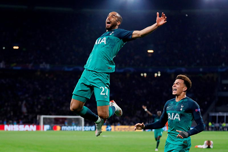 Tottenham's Lucas Moura celebrates scoring their third goal to complete his hat-trick with Dele Alli during the Champions League Semi Final Second Leg match between Ajax Amsterdam and Tottenham Hotspur, at Johan Cruijff Arena, in Amsterdam, Netherlands, on May 8, 2019. Photo: Action Images via Reuters