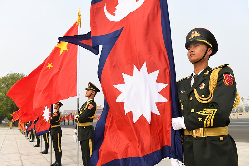 Chinese honour guards stand with Nepalese and Chinese flags ahead of a welcoming ceremony for Nepalese President Bidhya Devi Bhandari at the Great Hall of the People in Beijing, China April 29, 2019. Photo: Madoka Ikegami/Pool via Reuters