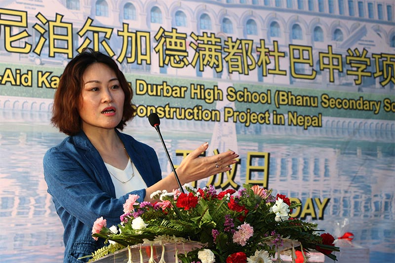 FILE - Chinese Ambassador to Nepal Hou Yanqi addresses a programm organise to inform the completion of main work of Durbar High School (Bhanu Secondary School) Construction Project in Nepal, on the premises of the school, in Kathmandu, on Friday, May 24, 2019. China's Shanghai Construction Group has been engaged to construct the school that was damaged in earthquake in April 25, 2015. Photo: RSS